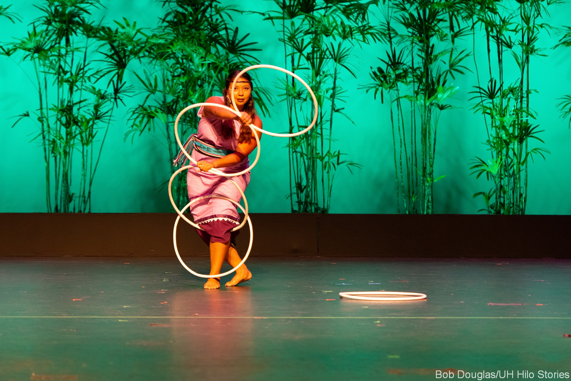 Woman dancing with hoops.