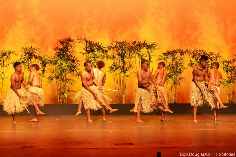 Male Kosrae dancers in grass dress with sticks