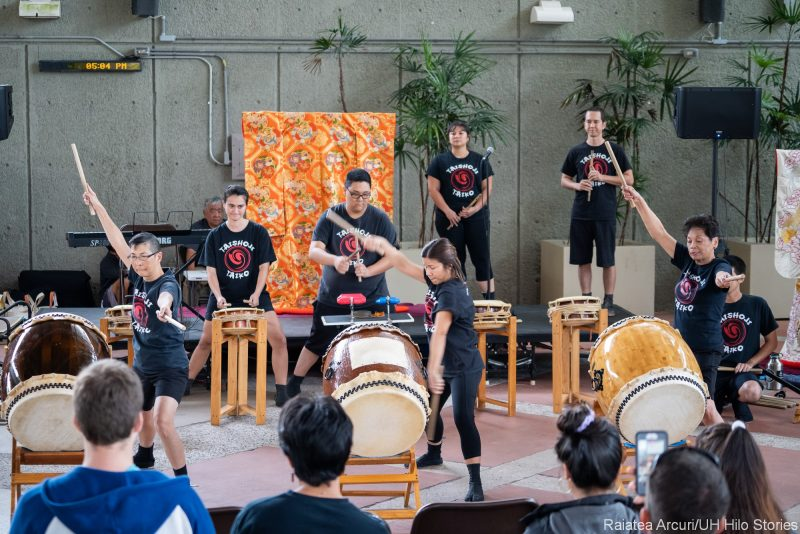 Taiko drummers on stage.