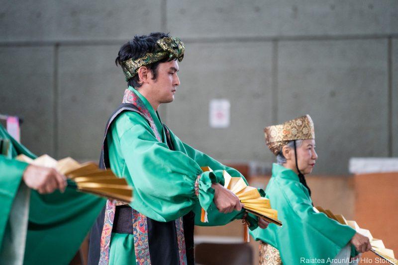 Perfomers doing Okinawan Dance.