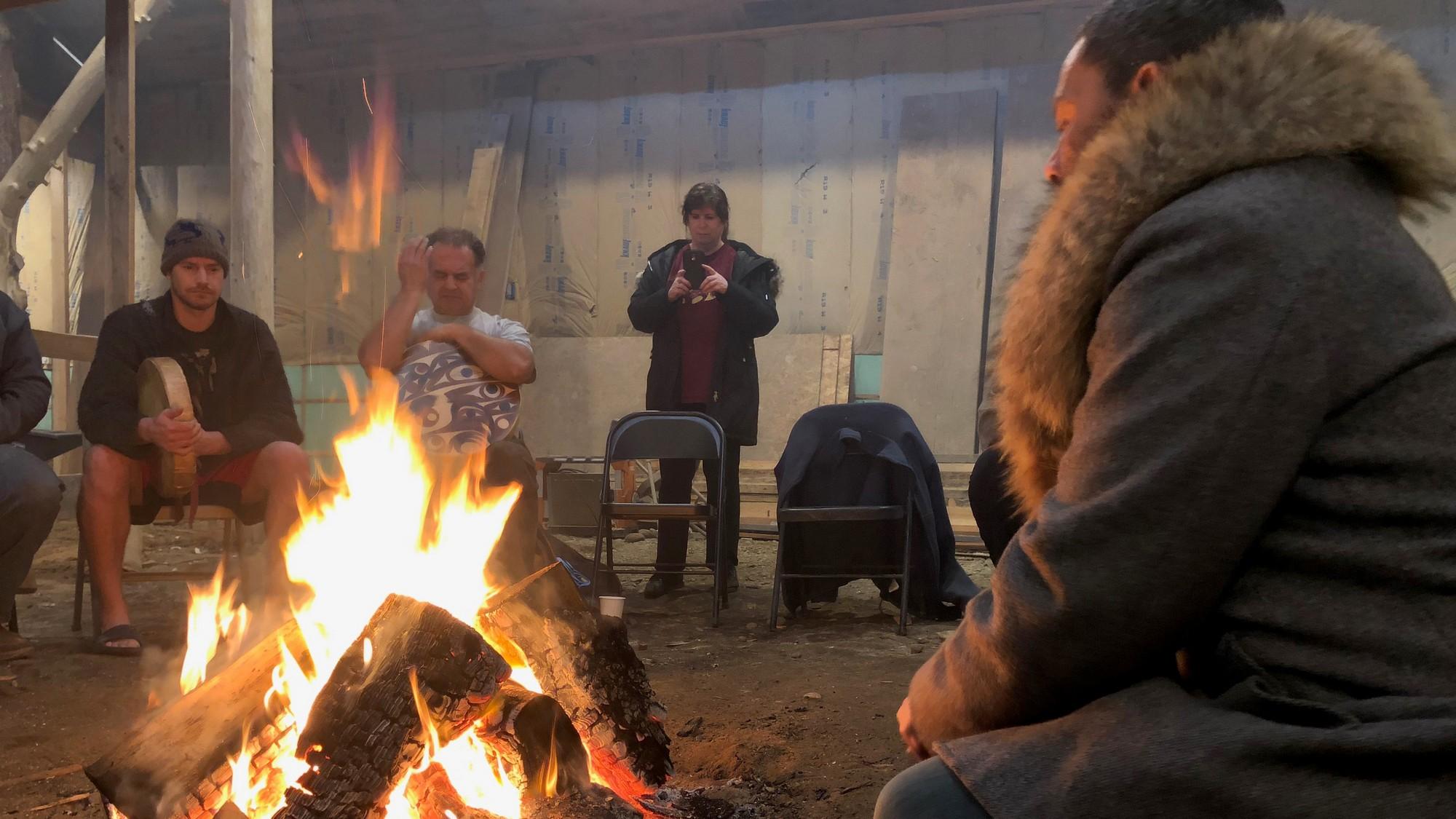 Gathered around a camp fire: Sy Miller, Dexter Miller; Tina Kuckkahn-Miller, and Taupōuri Tangarō.