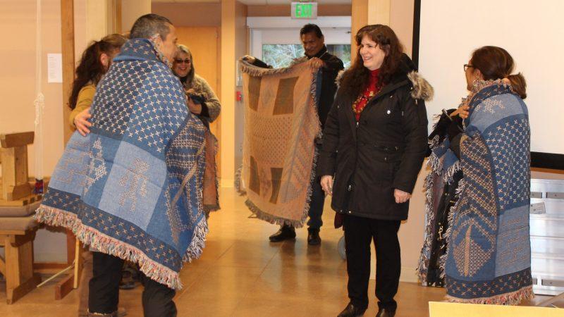 Taupōuri Tangarō, Gail Makuakāne-Lundin, Tina Kuckkahn-Miller enjoying gifts of blankets.