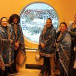 Each wrapped in blanket: Kekai Lindsey, Melanie Wilson, Kauil Kealiʻikanakaʻoleohaililani, Taupōuri Tangarō, Ākeamakamae Kiyuna, Ian Shortridge, Gail Makuakāne-Lundin, Hanalei Marzan.