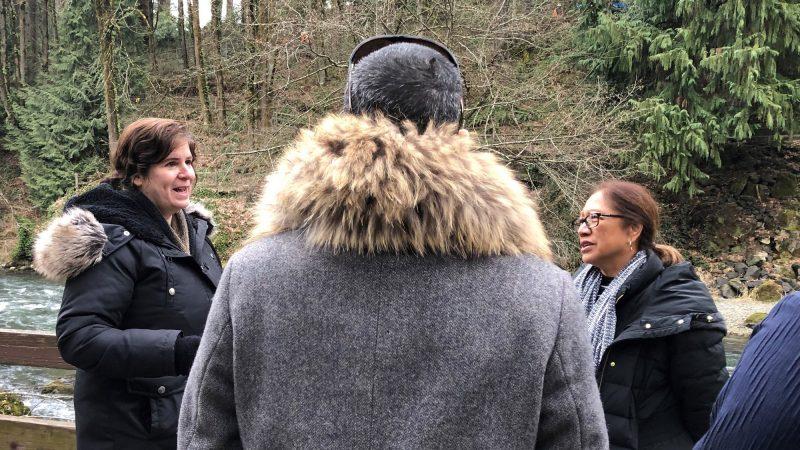 Tina Kuckkahn-Miller, Taupōuri Tangarō, and Gail Makuakāne-Lundin, water in background.