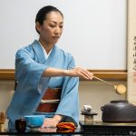 Woman performing tea ceremony.
