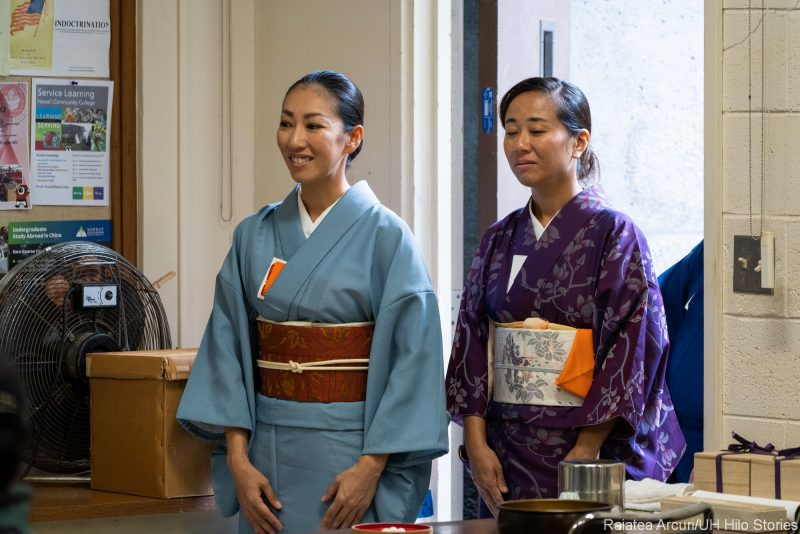 Two women in kimono being introduced.
