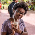 Student holding beverage.