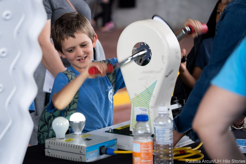 Boy learning how to generate electricity.
