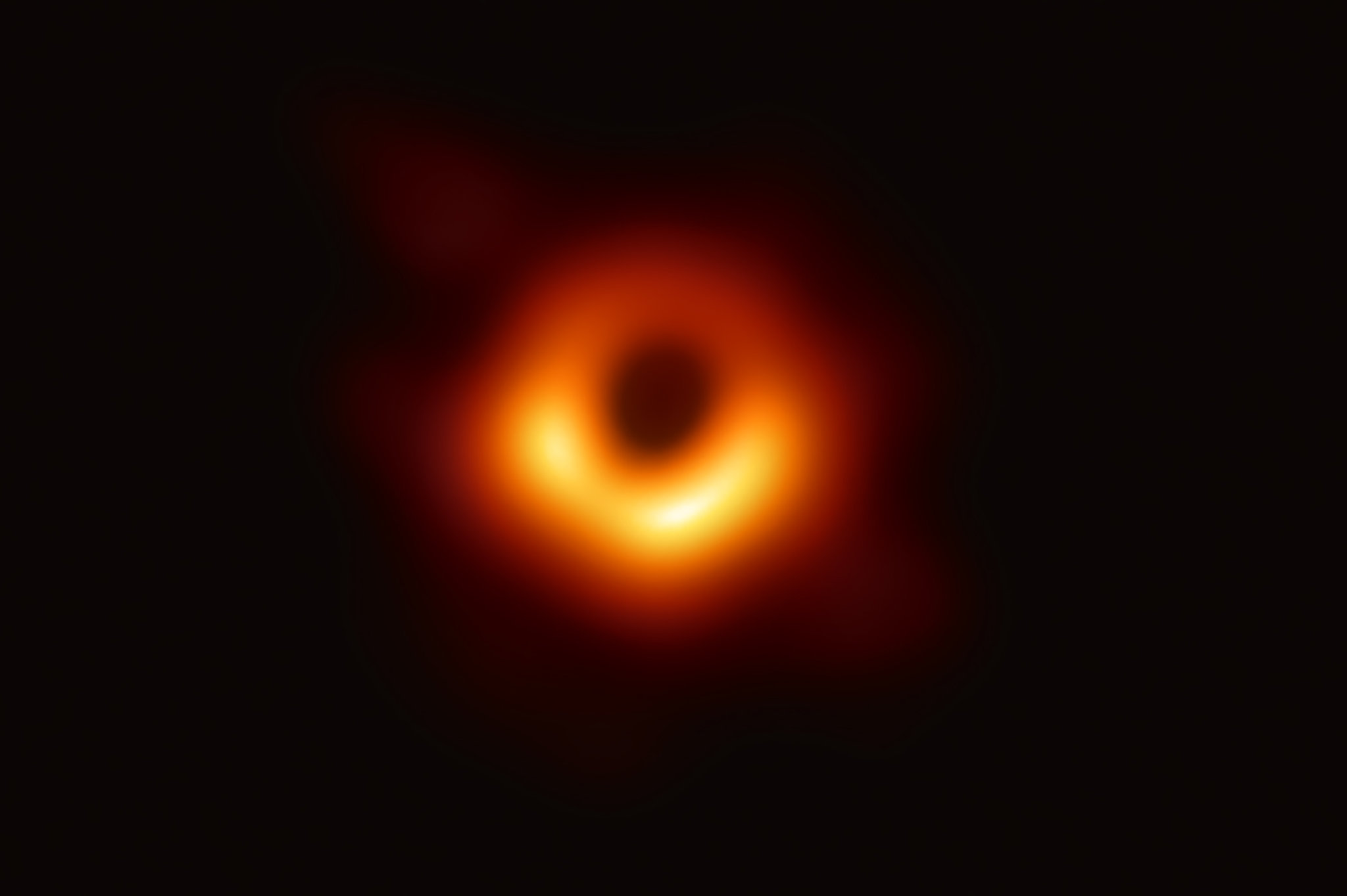 Black Hole Pōwehi, yellow and red ring in black space