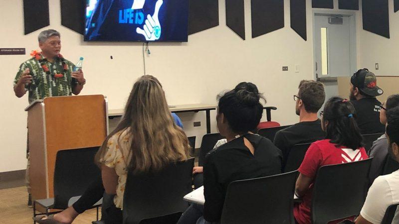 Randy at podium speaking to class.