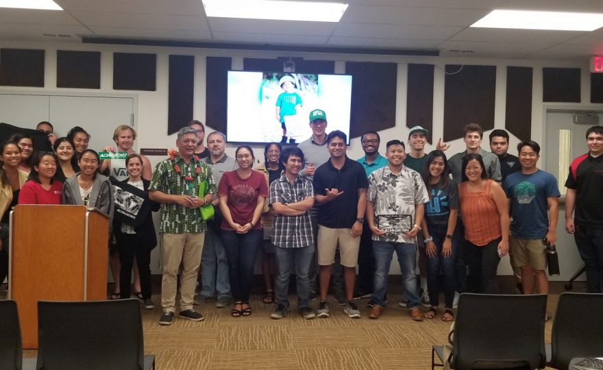 Group photo of students at front of the classroom with guest speaker Randy Kurohara.