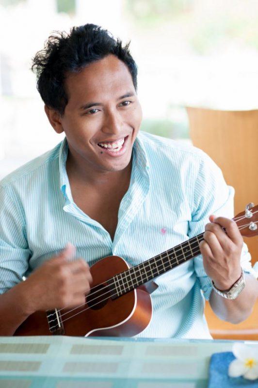 Matthew Therrien playing ukulele.