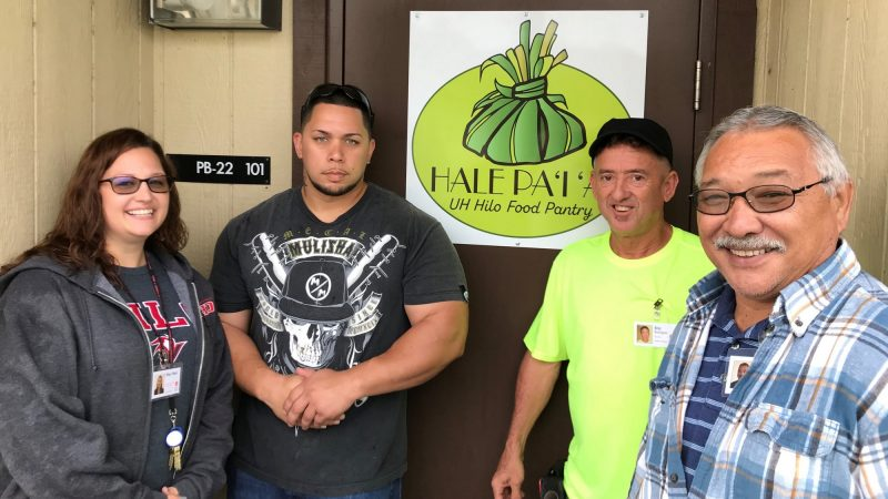 Shay Hara, Kapena Desa, Eric Rodrigues, and Calvin Fukuhara at doorway.