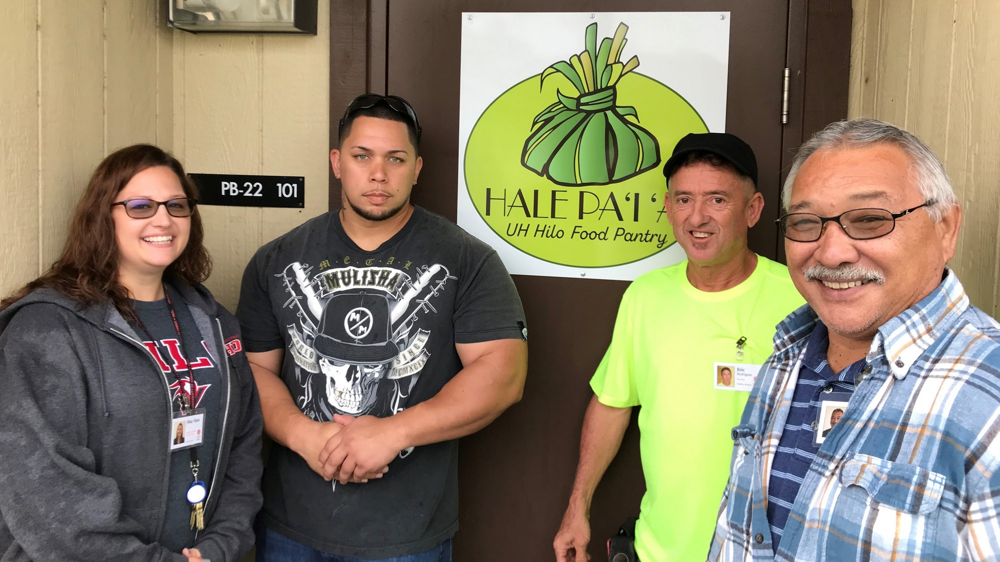 Shay Hara, Kapena Desa, Eric Rodrigues, and Calvin Fukuhara at doorway.