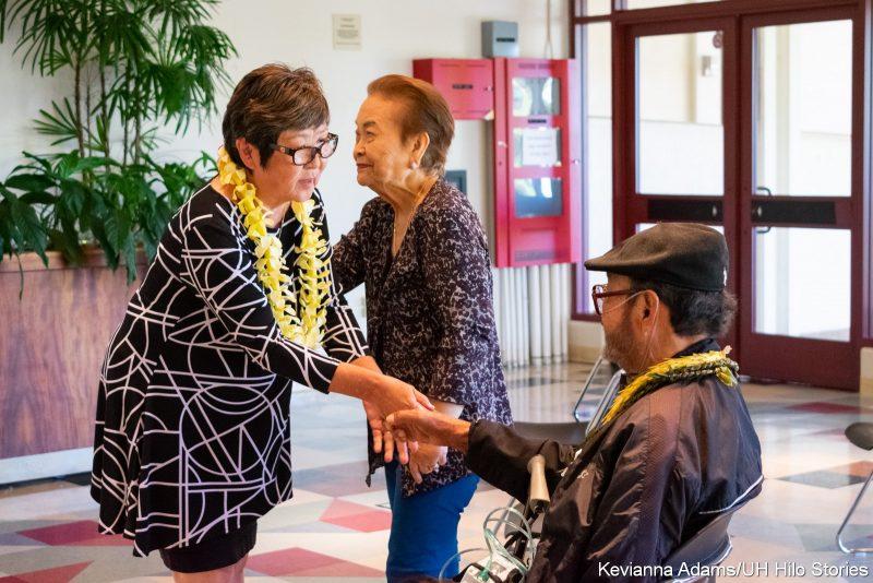 Chancellor Sakai shaking Fred Sorianos hand.