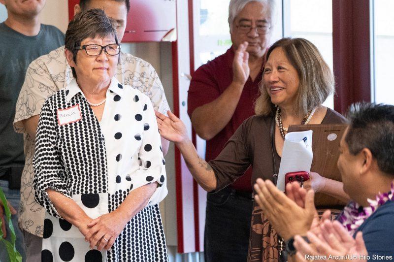 Gail Makuakāne-Lundin and others applaud Marcia Sakai.