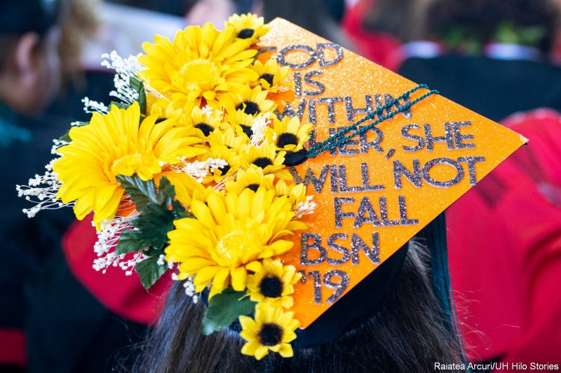 Mortarboard with words: God is within her, she will not fall. BSN 19