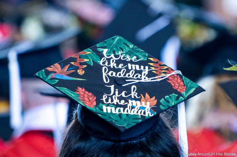 Mortarboard with words: Wise like my faddah; Tick like my maddah