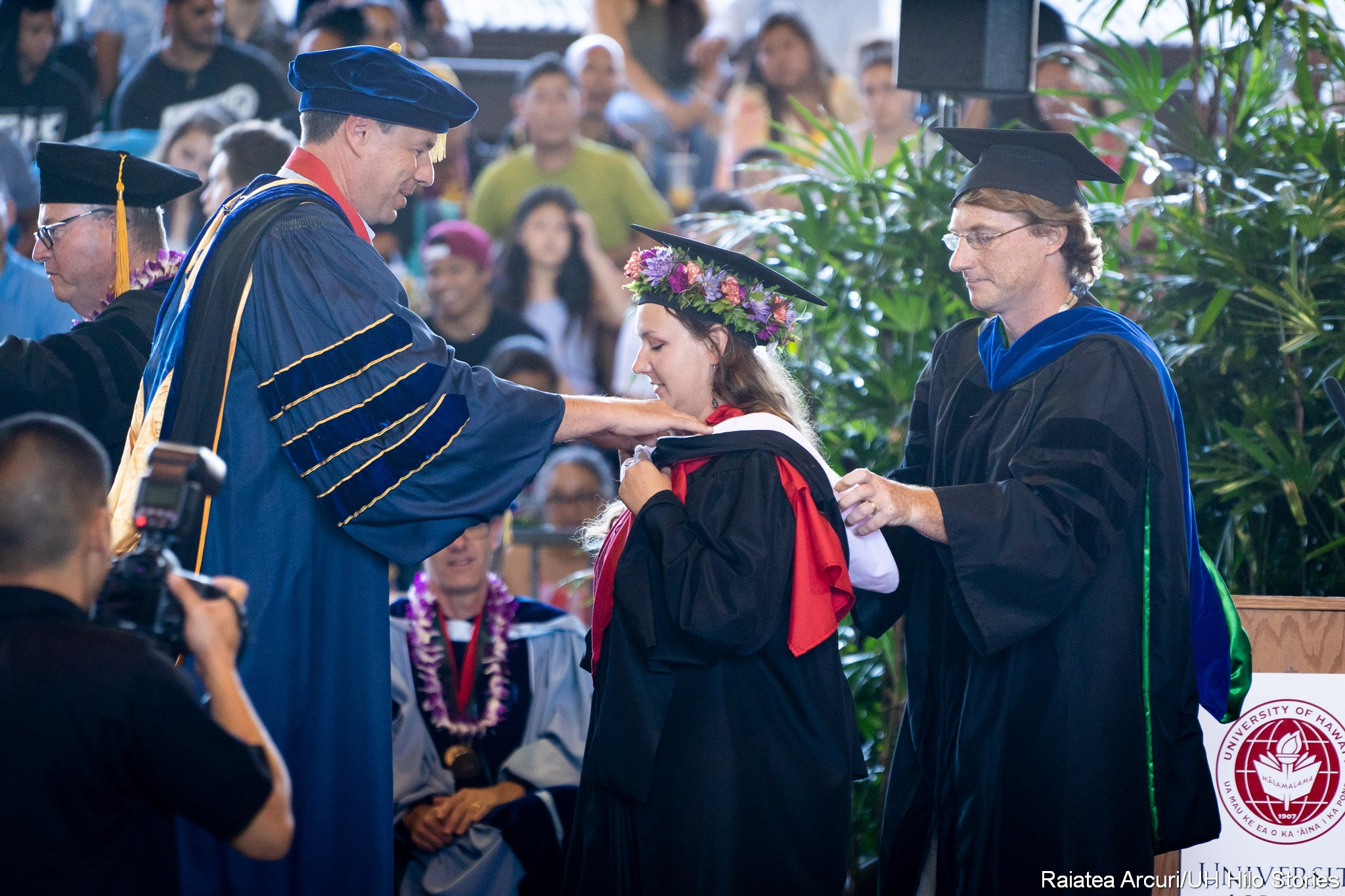 Graduate received hood.