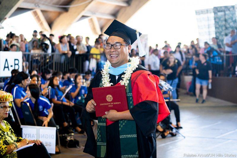Graduate with hood.