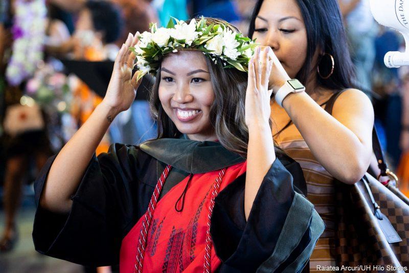 Graduate receiving haku lei.
