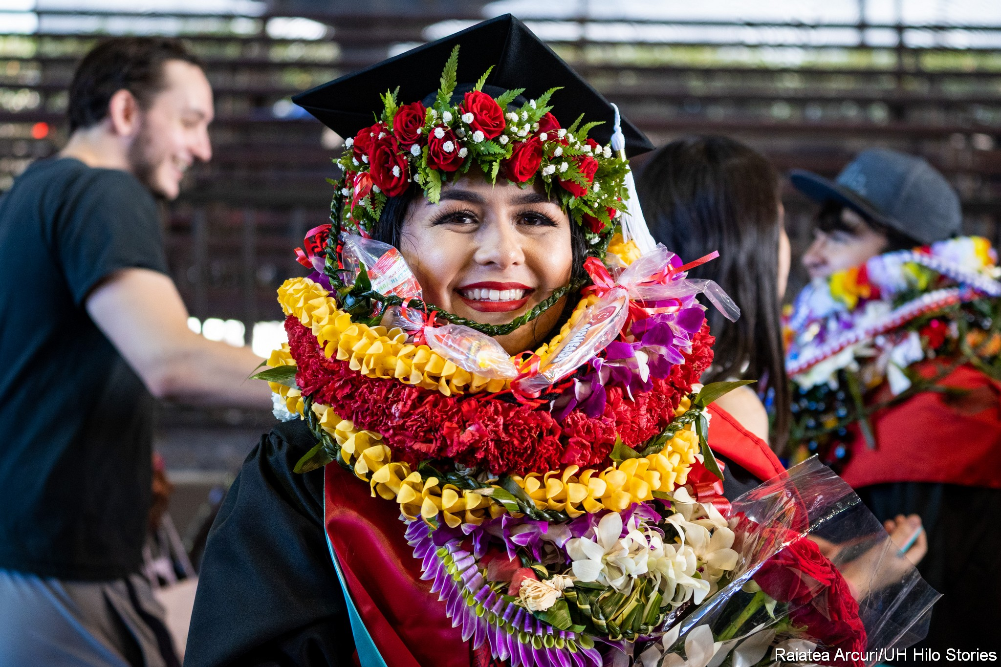 Graduate with many lei.