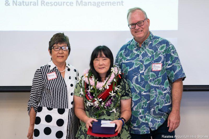 Marcia Sakai, Marcia Sakai and Bruce Mathews stand for photo.