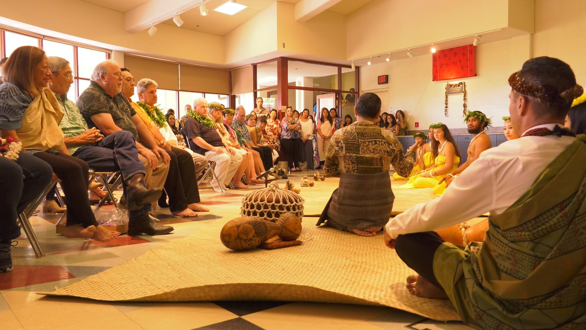 Audience watches Taupōuri Tangarō. speak.
