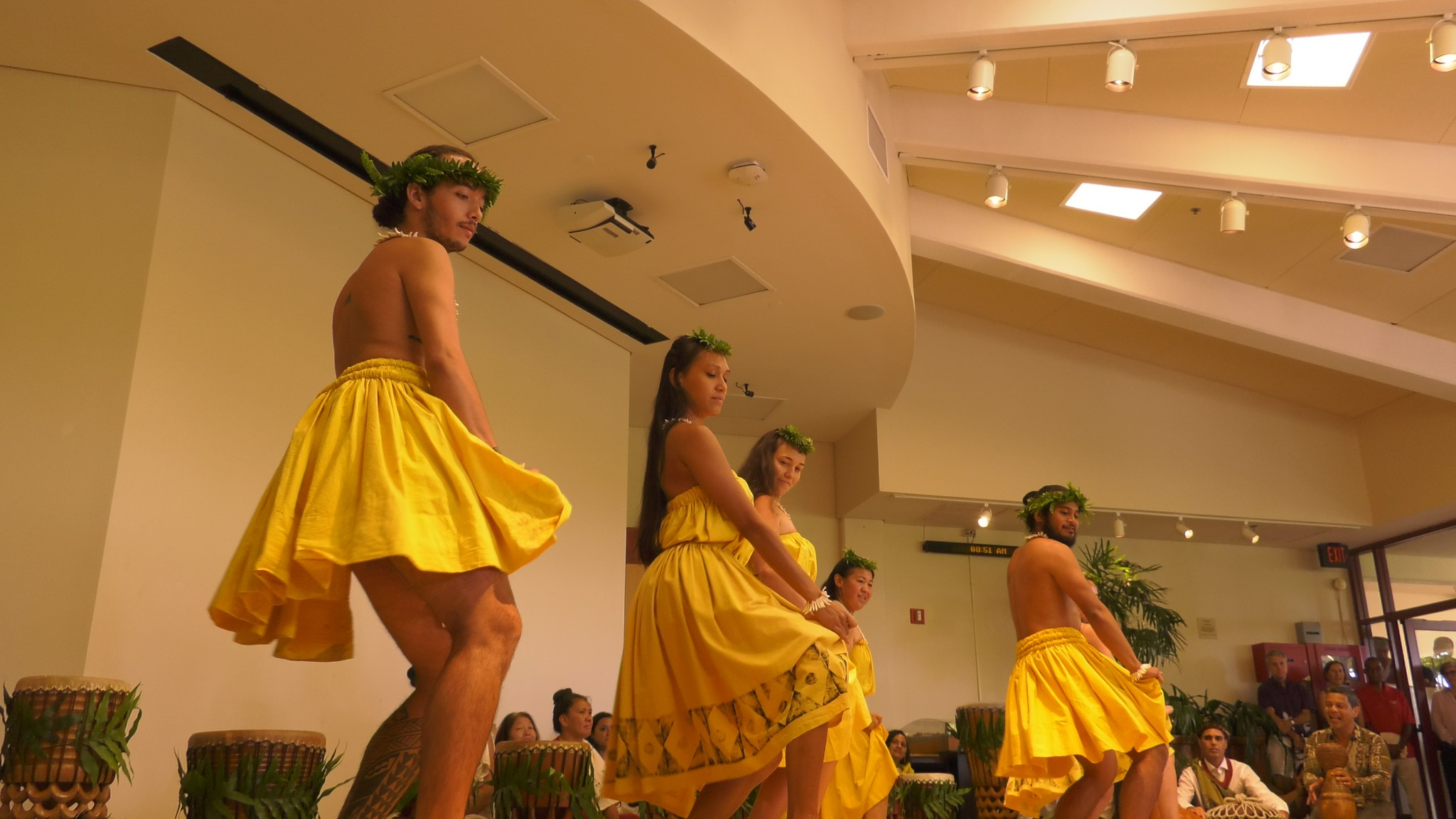 Dancers in yellow. Drums in background.