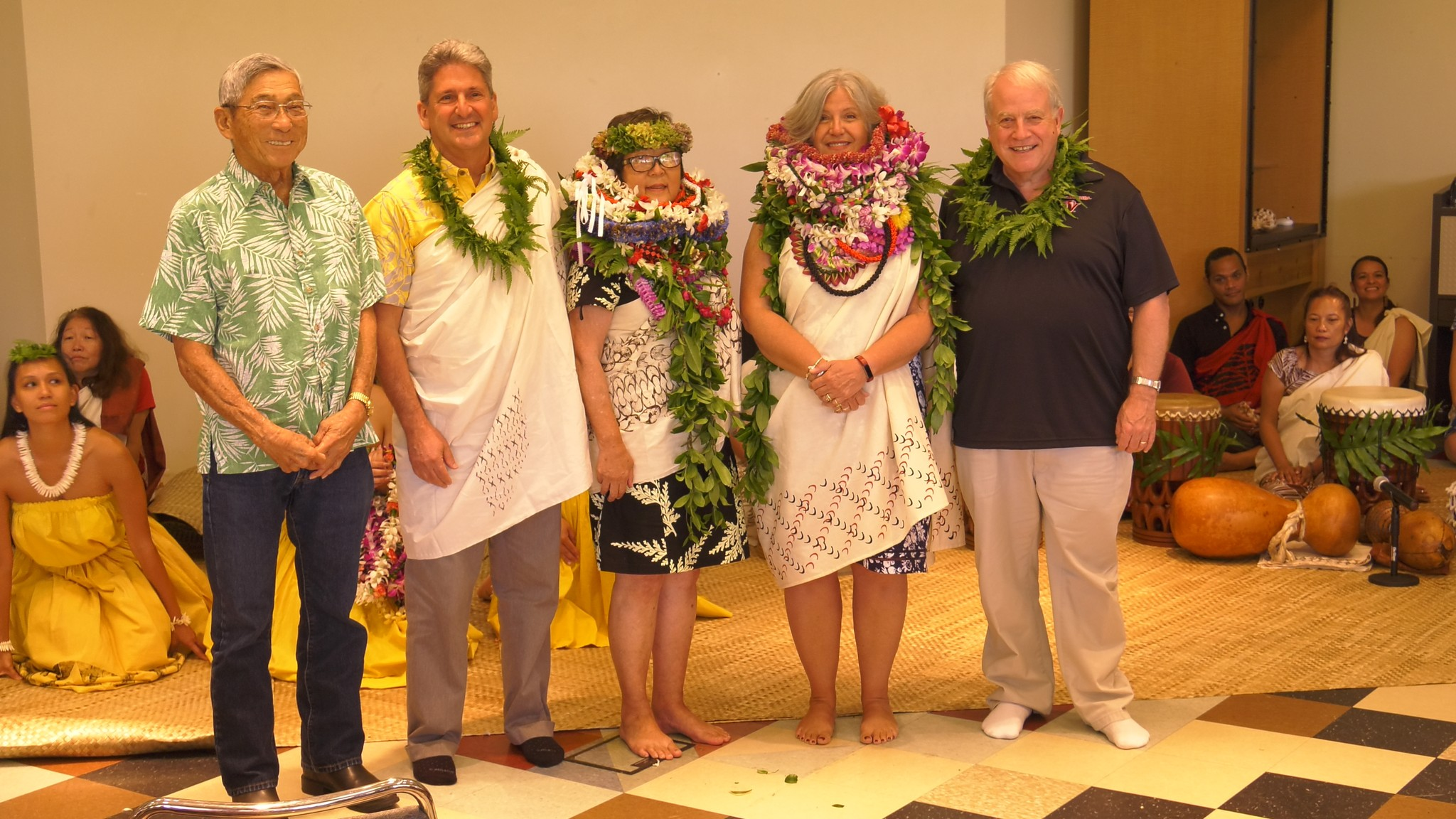 Group photo, standing, from left, From left: Hawaiʻi Island Mayor Harry Kim, UH President David Lassner, former interim Chancellor Marcia Sakai, Chancellor Bonnie D. Irwin and her husband author Ned Huston.