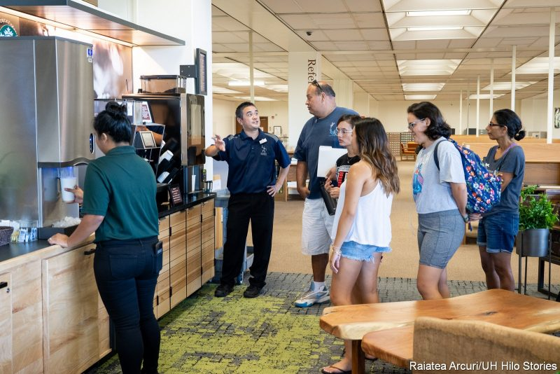 Staff help patrons with their coffee orders,