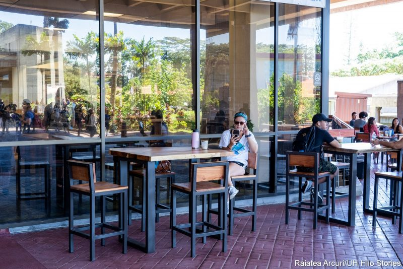 Students at one of the new tables on the Library Lanai.