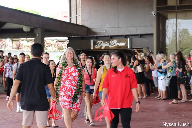 Chancellor Irwin leads the group to the Library Lanai.