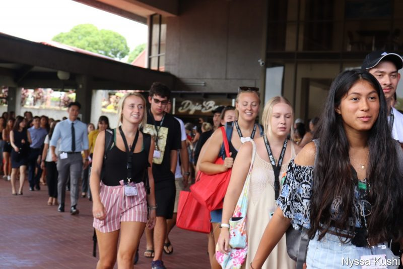 Group of young women walking to the Library Lanai.