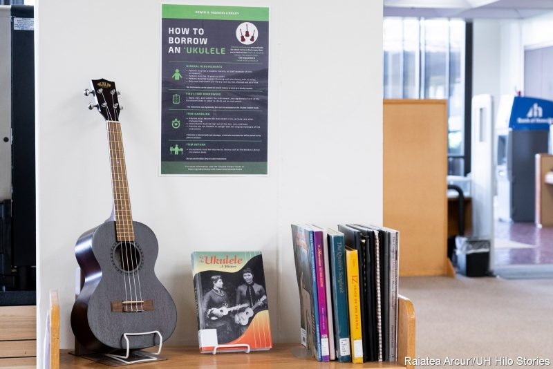 Display with ukulele and instruction son how to borrow instruments.