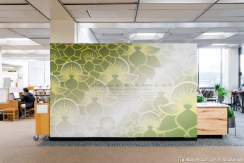 Wall located in lobby of library with decorative ohia print.