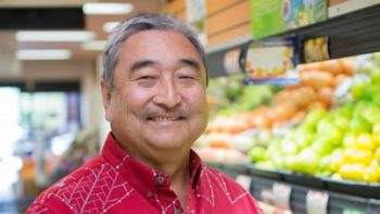 Barry Taniguchi in the produce section of KTA.