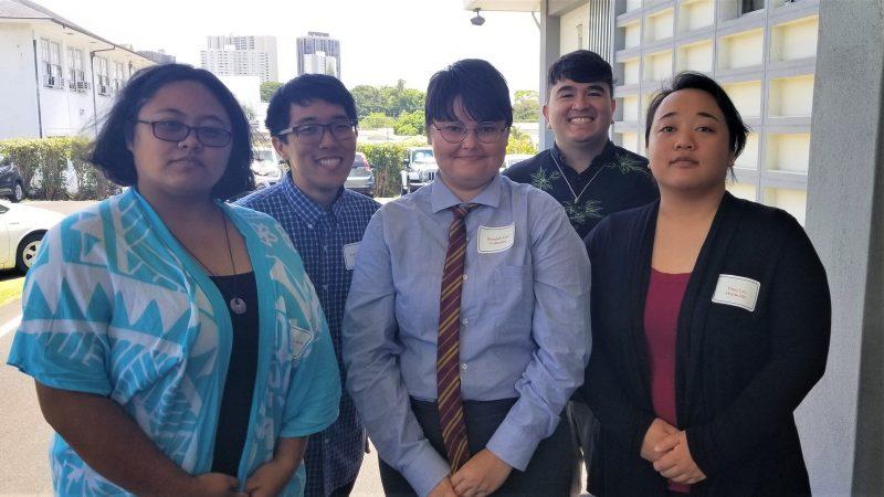 Group photo of five alumni.