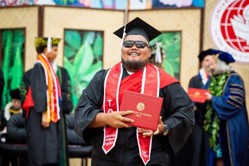 Man graduate in sunglasses.