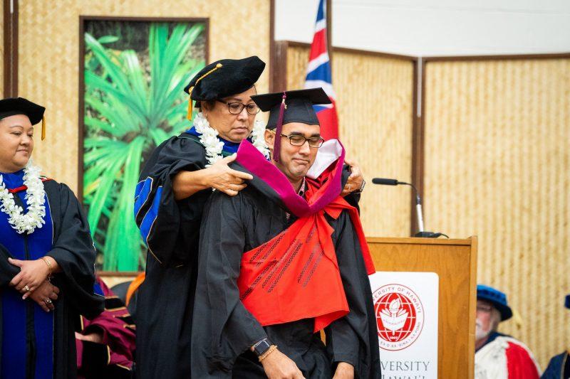 Graduate receives hood.