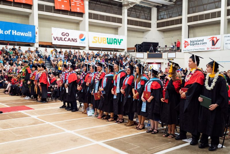 Graduates stand in preparation of recessional.