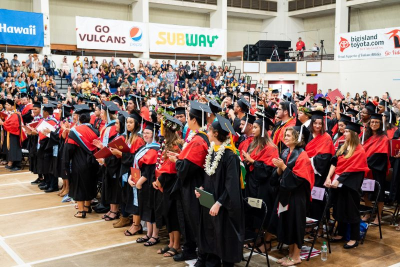 Student stand before recessional.