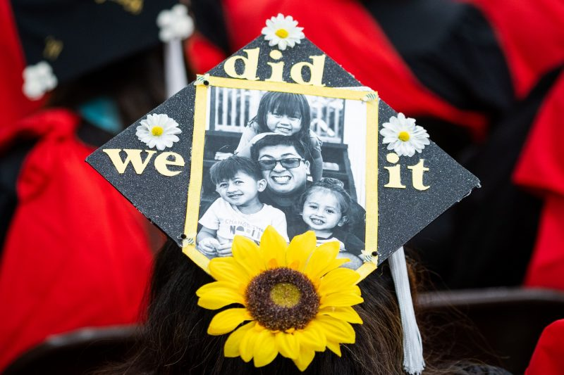 Top of mortarboard with a family photo and the words: We Did It