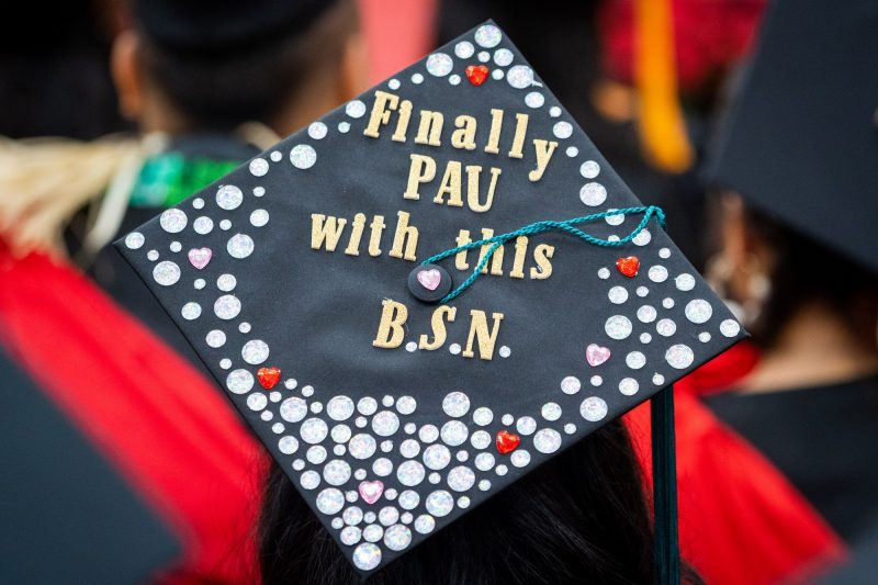 Top of mortarboard with the words: Finally all pau with this BSN