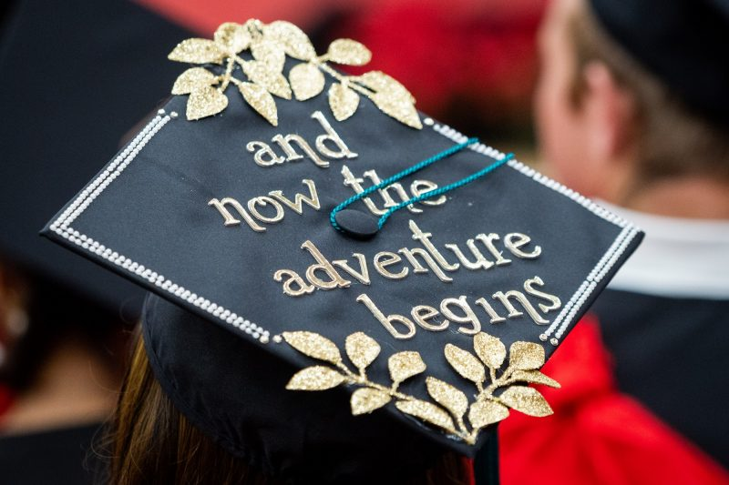 Top of mortarboard with the words: And now the adventure begins
