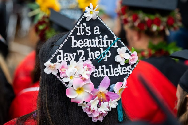 Top of mortarboard with the words: It's a beautiful day 2 help athletes