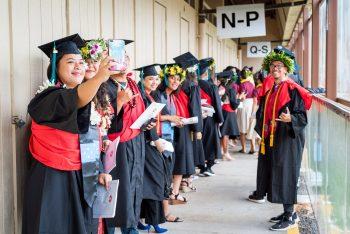 Graduates talking selfie.