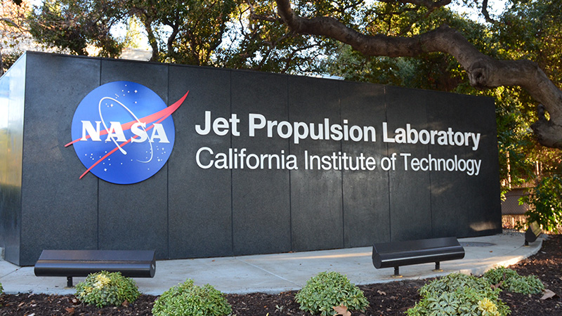 Signage at the main entrance of the facility: NASA Jet Propulsion Laboratory, California Institute of Technology.