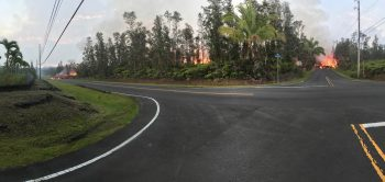 Looking into the distance from a fork in the road. both forks have encroaching red-hot lava advancing on the roads.