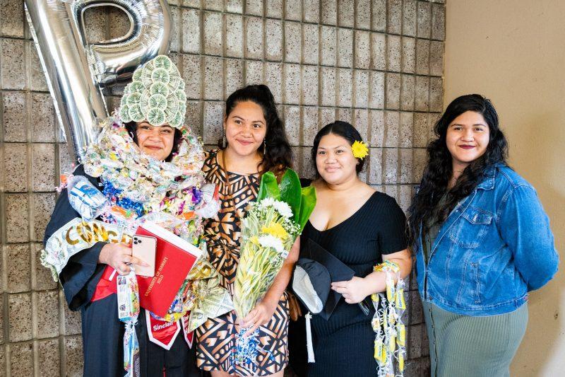 Graduates with head dresses.